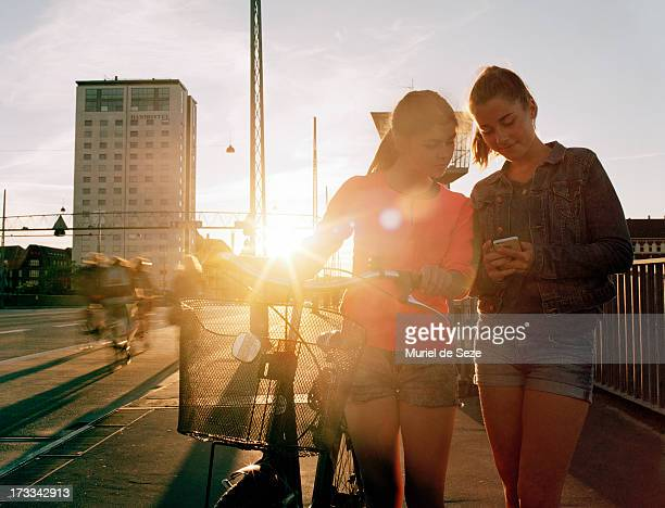Teenage girls by sunset