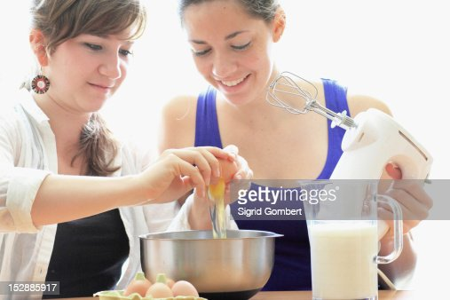 Teenage girls cooking together
