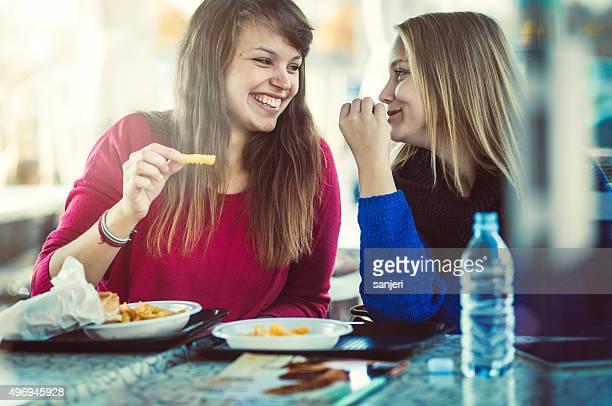 Teenage girls eating fast food