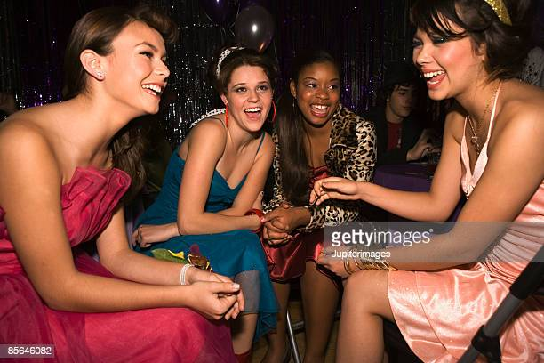 Teenage girls engaged in conversation at prom