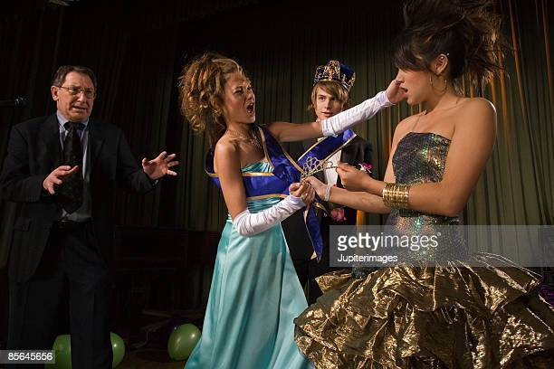 Teenage girls fighting at prom