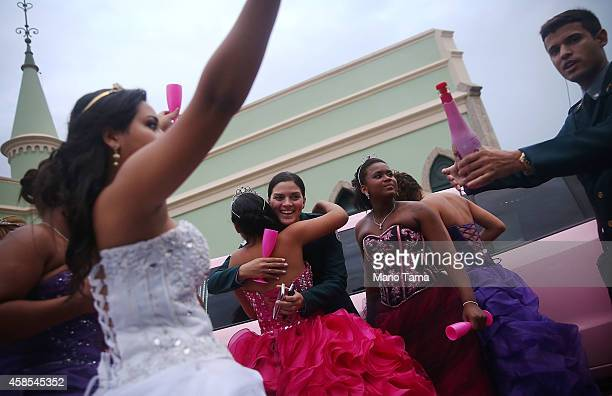 Teenage girls from the CerroCora 'favela' or community celebrate with a UPP officers at a group debutante ball at Ilha Fiscal castle organized by the...
