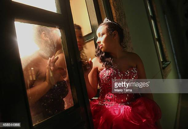 Teenage girls from the CerroCora 'favela' or community wait for a debutante ball to begin at Ilha Fiscal castle organized by the Pacifying Police...