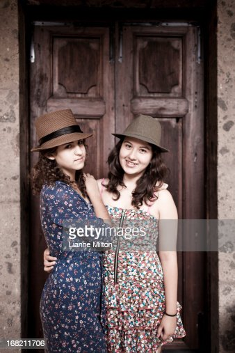 Teenage girls hanging out at home : Stock Photo