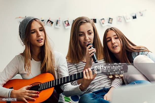 Teenage Girls Has Karaoke Party.