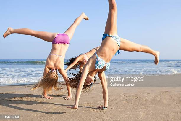 Teenage girls having fun at the beach.