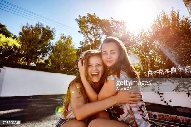 Teenage girls having fun in residential street, Cape Town, South Africa