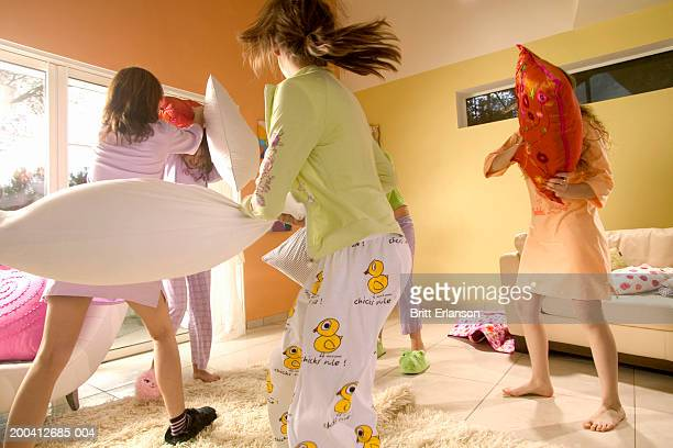 Teenage girls (12-17) having pillow fight
