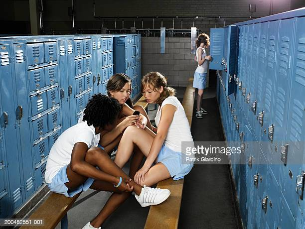 Teenage girls (13-16) in gym locker room