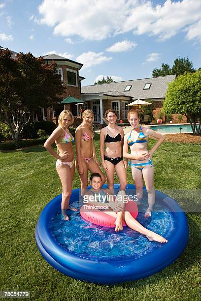 Teenage girls in kiddie pool