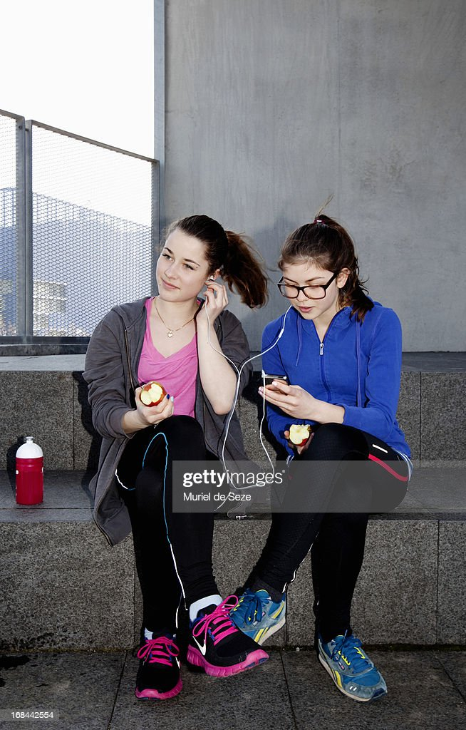 Teenage girls listening to music : Stock Photo
