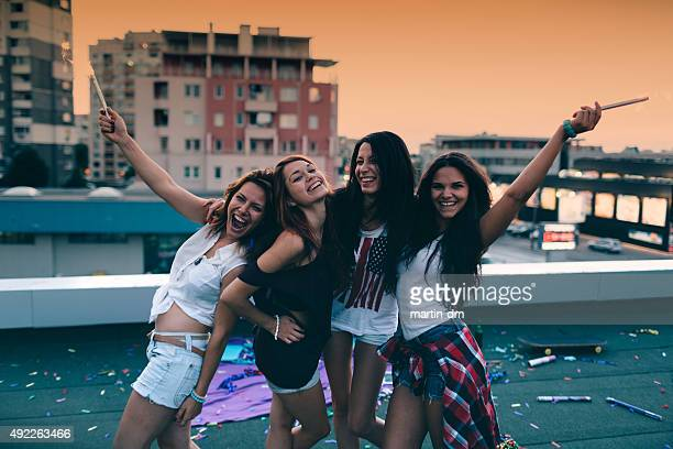 Teenage girls on a rooftop party