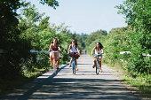 Teenage girls on bicycle