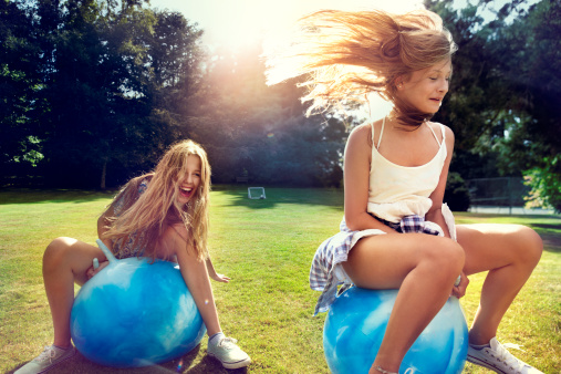 Teenage girls on Space Hopper