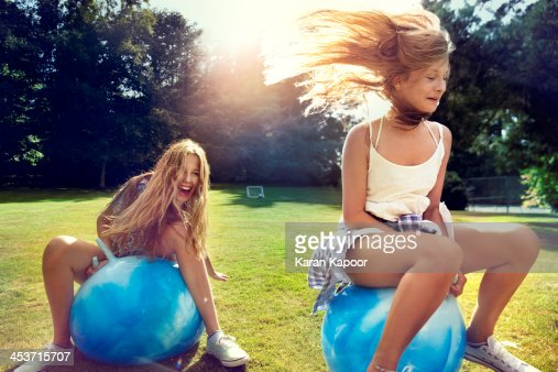 Teenage girls on Space Hopper : Stock Photo