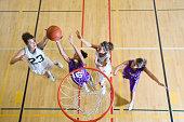Teenage girls (16-19) playing basketball, elevated view