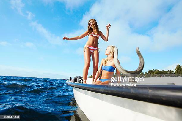 Teenage girls relaxing on sailboat