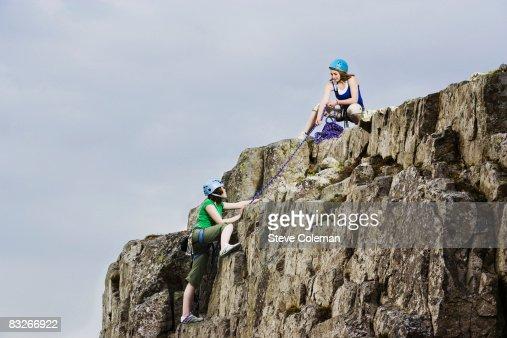 Teenage girls rock climbing : Stock Photo