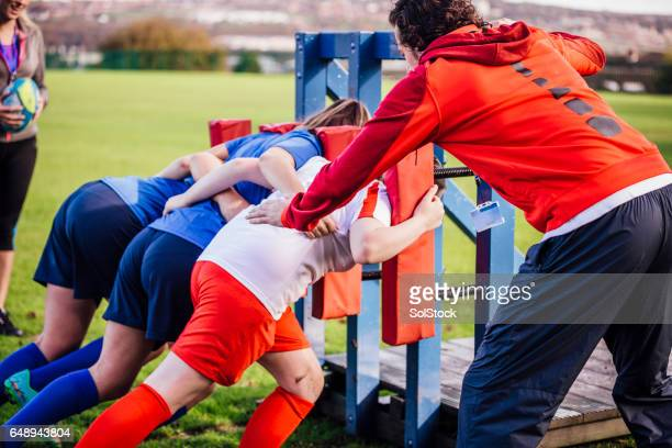 Teenage Girls Rugby Training with their Coach