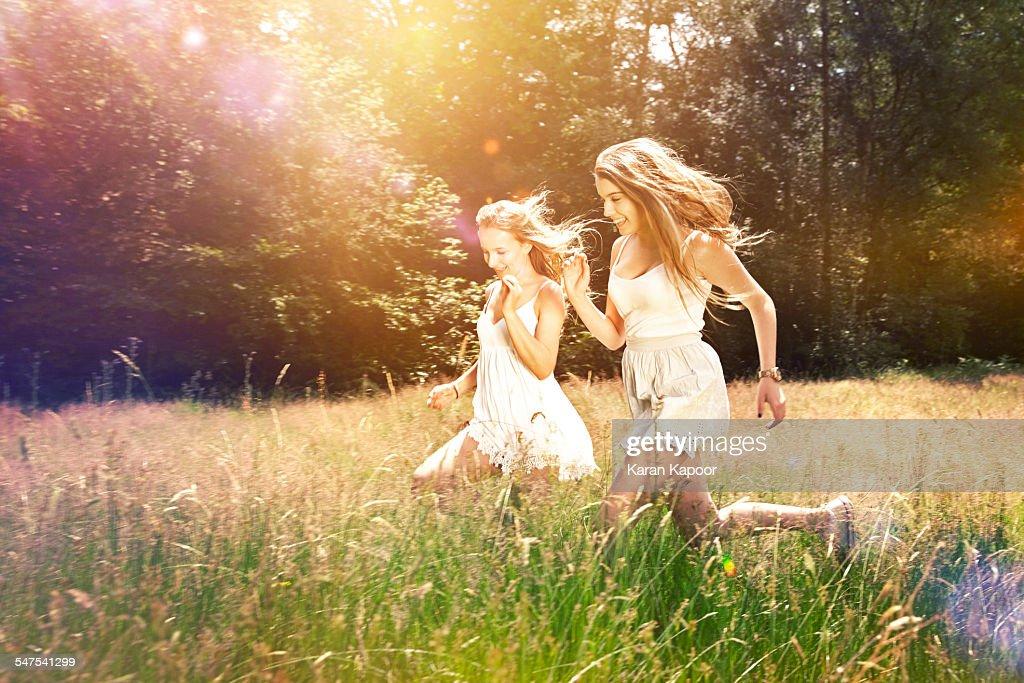Teenage girls run in field