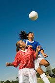 Teenage Girls Shoving for Soccer Header