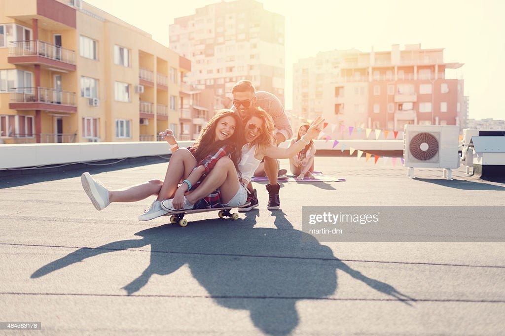 Teenage girls skateboarding on the rooftop