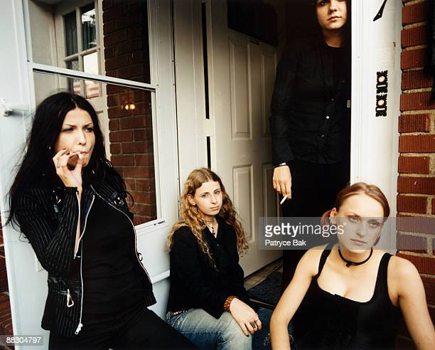 Teenage girls smoking on porch