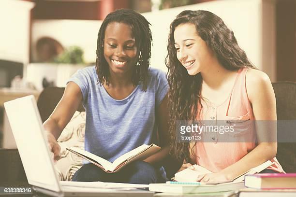 Teenage girls studying, doing homework at home.
