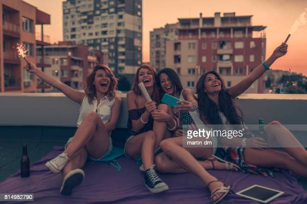 Teenage girls taking selfie on rooftop party