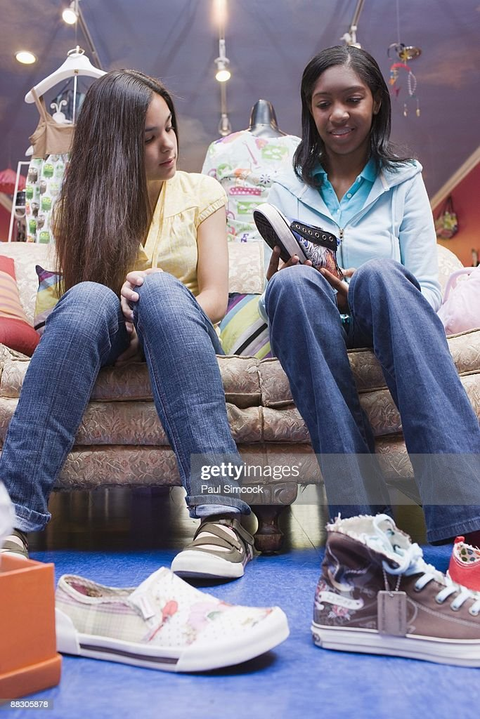 Similar images. Teenage Girls Trying On Shoes In Shop Stock Photo   Getty Images