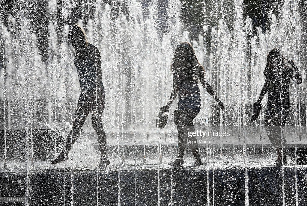 Teenage girls walk through a park fountain on May 17, 2014 in Donetsk, Ukraine. Civilians tried to get on with their daily lives in Dontesk as the political and military crisis continued in eastern Ukraine ahead of presidential elecitons scheduled for May 25.