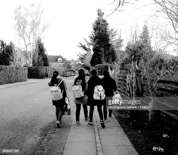 Teenage Girls Walking On Footpath