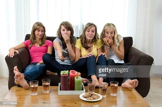 teenage girls watching tv show