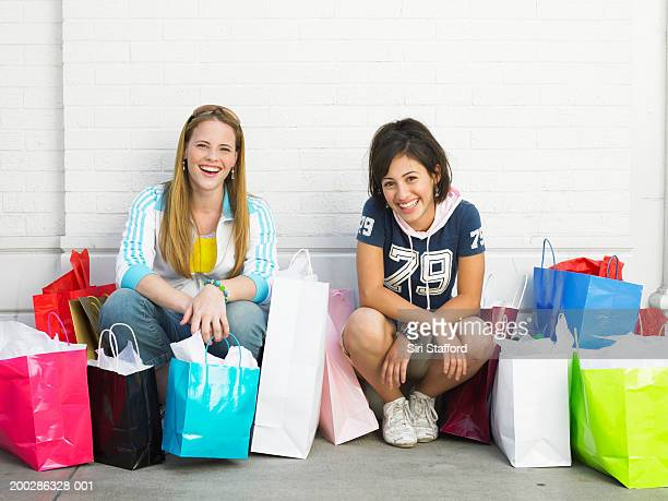 Teenage girls (17-19) with  shopping bags