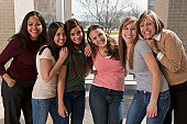 Teenage girls with their mothers in college at parent's weekend