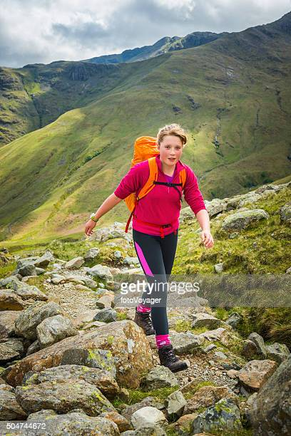 Teenage hiker walking on mountain path Langdale Lake District UK