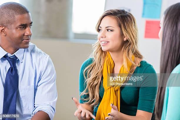 Teenage Hispanic girl talks in group therapy
