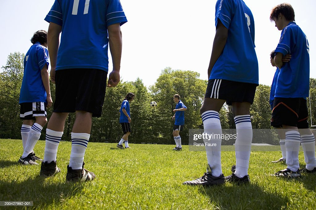 Teenage male (16-20) soccer players practicing skills : Stock Photo
