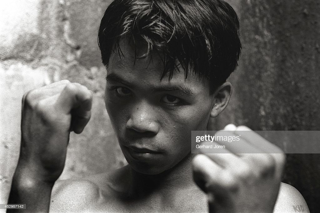 A teenage <a gi-track='captionPersonalityLinkClicked' href=/galleries/search?phrase=Manny+Pacquiao&family=editorial&specificpeople=3855506 ng-click='$event.stopPropagation()'>Manny Pacquiao</a>, the Philippino boxer who went on to become a world champion sensation. He is seen here at the LM Gym in Manila.