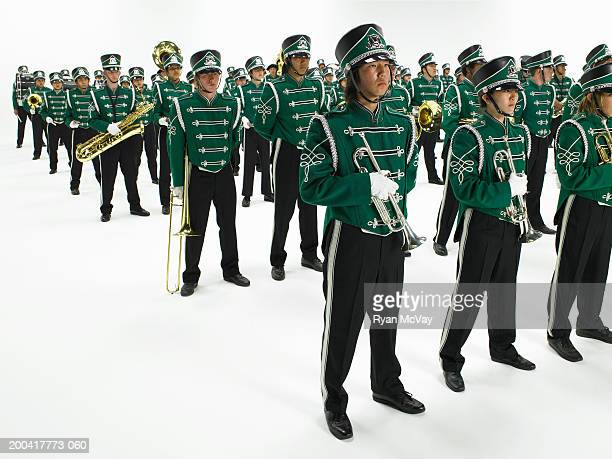 Teenage (14-18) marching band standing in rows