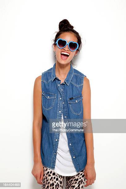 Teenage model in hear shaped glasses laughing