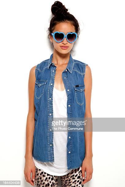 Teenage model in heart shaped glasses