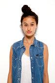 Teenage model in studio posing in denim for camera
