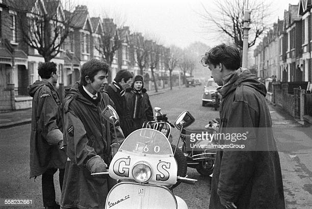 Teenage mods in parkas on their Vespa scooters London 1964