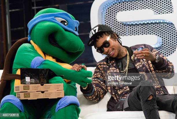 Teenage Mutant Ninja Turtle Leonardo and rapper Wiz Khalifa attend SKEE Live at The Conga Room at LA Live on November 19 2013 in Los Angeles...
