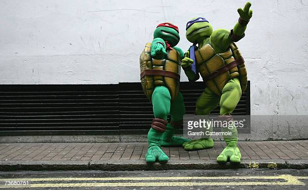 Teenage Mutant Ninja Turtles characters Raphael and Donatello pose outside Hamleys toy store on March 23 2007 in London England The turtles were in...