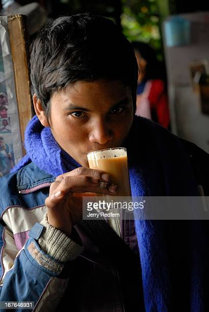 A teenage paper seller takes a cup of milkheavy tea at the Hot Stimulating Cafe The small shop specializes in momos Tibetan dumplings and spiced tea
