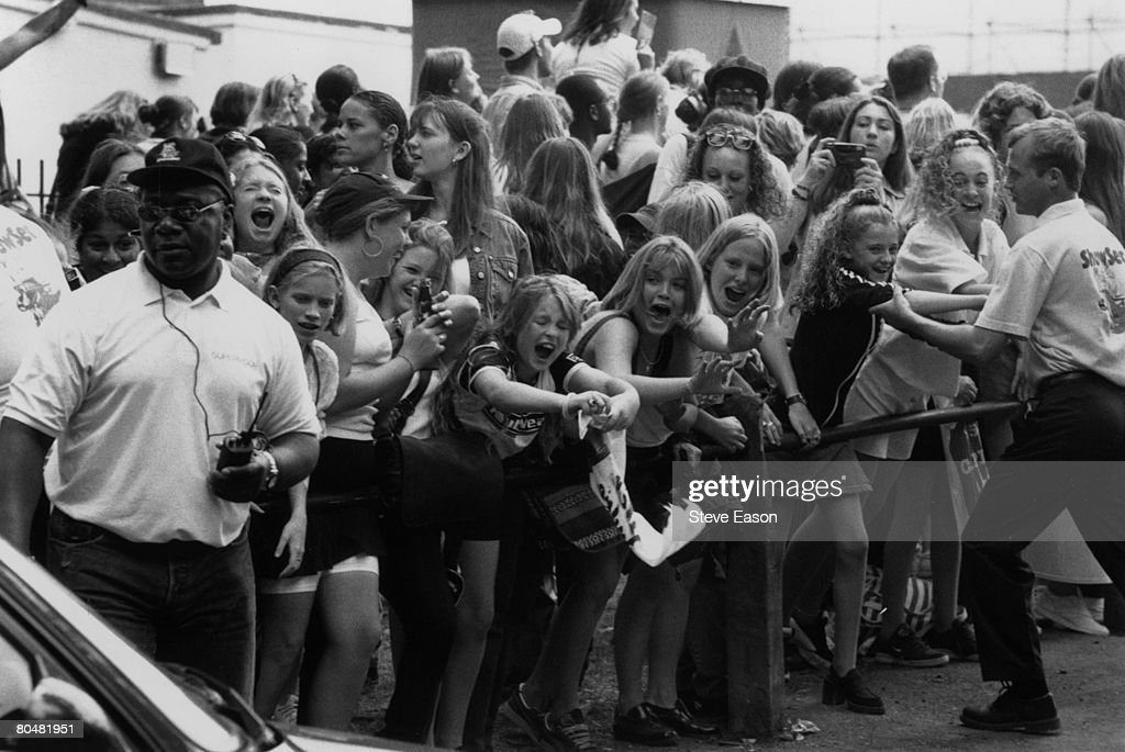 Teenage pop fans waiting for the Capital Radio Concert at Clapham Common in London, 28th July 1996.