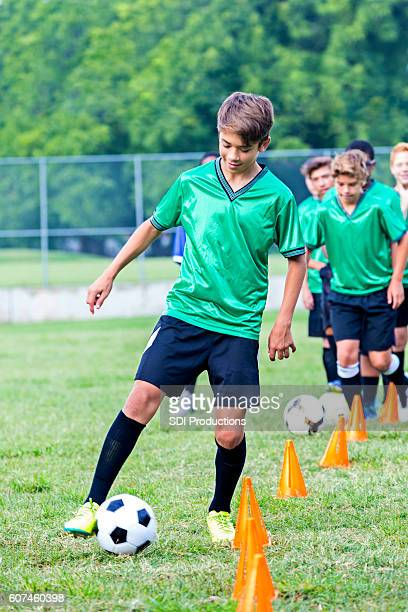Teenage soccer player at practice