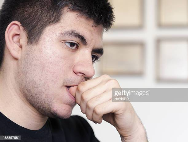 Teenage Student biting nails.